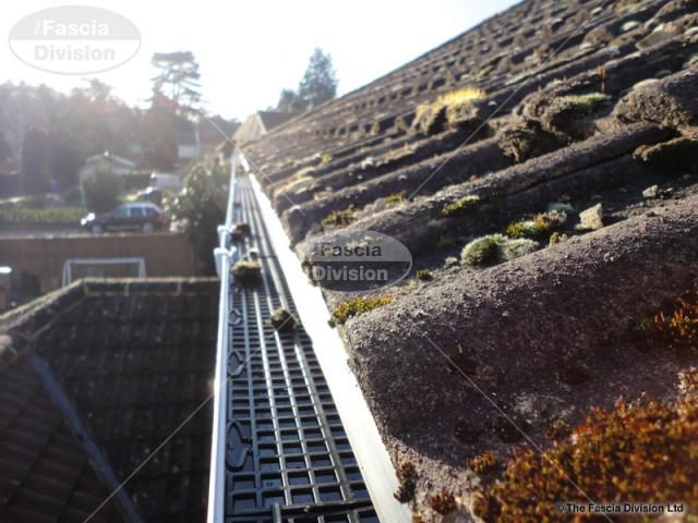 gutter guard grid fitted beneath the line