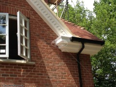 Decorative fascias and soffits dentil mouldings with black ogee guttering Haslemere Surrey