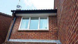 Black Ash fascia with White tongue and groove soffit and Black square guttering in Romsey, Hampshire