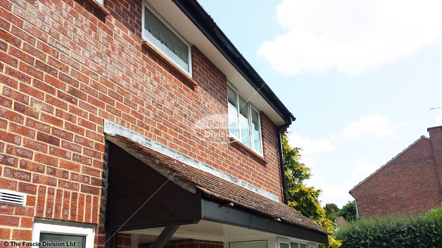 Black Ash fascia with White tongue and groove soffit and Black UPVC squareline guttering in Romsey, Hampshire