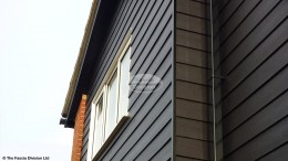 Black Hardieplank cladding, Black Ash fascias and soffits with Black replacement guttering Oxford