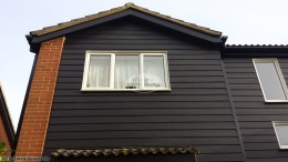 Hardiplank cladding with UPVC Black Ash fascias and soffits Oxford