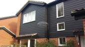 Midnight Black Hardieplank cladding with Black Ash fascias and soffits Oxford