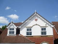 White decorative fascia with swish roof spires