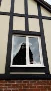Black mock tudor beams with cream render board installation