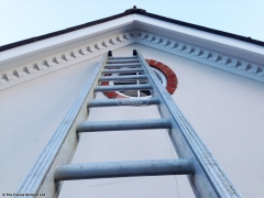 Installation of dentil mouldings on the gable end