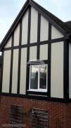 Installation of new replica oak tudor beams in black
