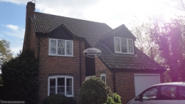 Black ash cladding replacement fascias soffits and guttering Berkshire black downpipe