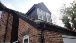 Black ash detached property cladding replacement fascias soffits and guttering Berkshire black downpipe