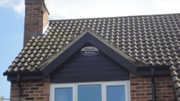 Installation of new black ash fascias soffits guttering cladding rooftrim black downpipe Berkshire
