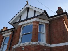 Concave decorative fascia with new Replica Wood black mock tudor beams