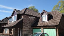 Installation of new rosewood UPVC shiplap cladding, fascias and soffits with UPVC brown guttering