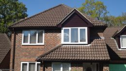 rosewood UPVC shiplap cladding, fascias, soffits and UPVC brown guttering