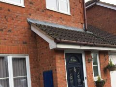Before installation showing wooden fascia and soffit
