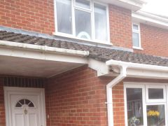 Before the installation showing wooden fascia damage caused by birds