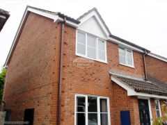 Installation of UPVC white fascia and soffit with brown square guttering in Eversley
