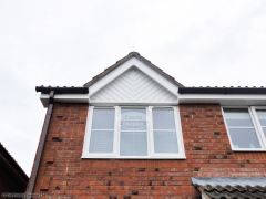 Installation of UPVC white herringbone cladding and white fascia in Eversley