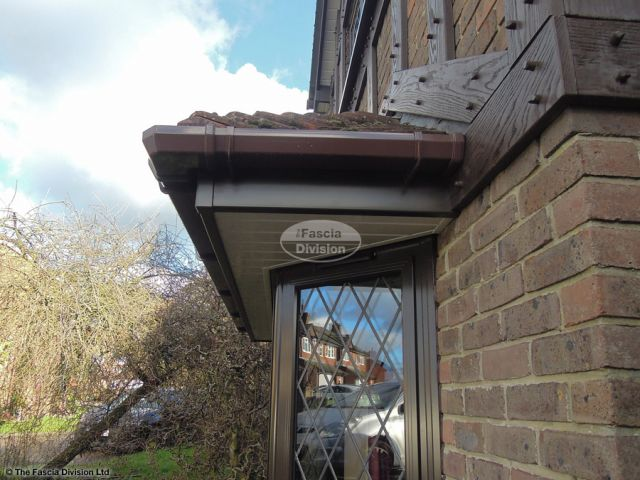 Brown square guttering with rosewood fascia and white soffit