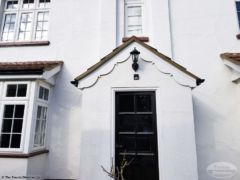 Decorative bargeboards on a porch gable after installation